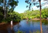 A refreshing walk in the river on Your Cape York Tour From Cairns