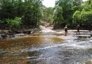 Walking a river crossing before taking the 4WD truck through